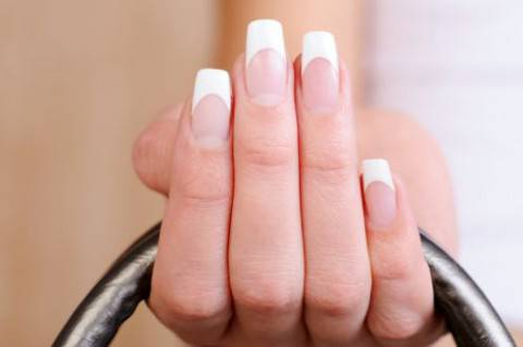 manicured-hand-with-french-nails