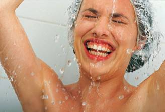 getty_rf_photo_of_woman_taking_a_quick_warm_shower