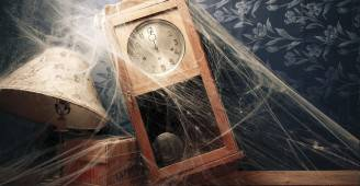 vintage wall clock full of cobwebs