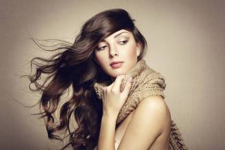 Portrait of a beautiful young woman with scarf