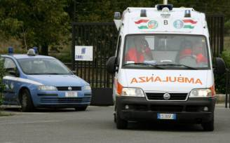 Italian police and an ambulance van leav