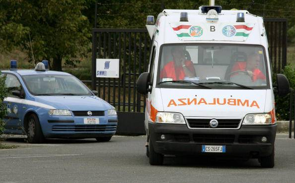 Italian police and an ambulance van leav
