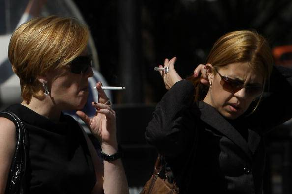 TO GO WITH AFP STORY  Two women smoke as