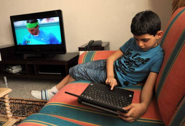 6 year old  Khalil plays with his PC lap