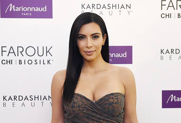 US reality TV star Kim Kardashian poses during a photocall to present her new cosmetic brand in Paris on April 15, 2015 .    AFP PHOTO / LOIC VENANCE        (Photo credit should read LOIC VENANCE/AFP/Getty Images)