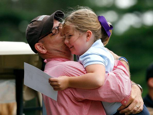 PLYMOUTH, MA - AUGUST 12:  A participant gets a hug from her dad after she participated  in the drive competition during the Drive, Chip and Put Regional Championship, Girls 7 - 9 Division, at Pinehills Golf Club on August 12, 2013 in Plymouth, Massachusetts.  Vemuri  will advance to the finals at Augusta National Golf Club in April 2014. (Photo by Jim Rogash/Getty Images for the DC&P Championship)