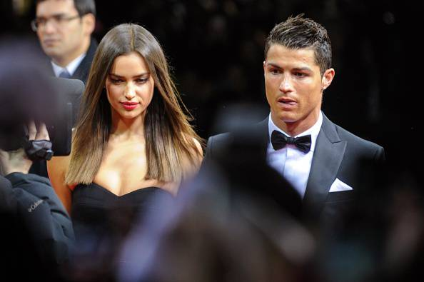 Real Madrid's Portuguese forward Cristiano Ronaldo (R) and his girlfriend Russian model Irina Shayk arrive at the FIFA Ballon d'Or awards ceremony at the Kongresshaus in Zurich on January 7, 2013. AFP PHOTO / SEBASTIEN BOZON         (Photo credit should read SEBASTIEN BOZON/AFP/Getty Images)