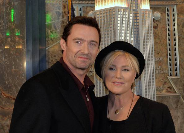 Hugh Jackman (L) and wife Deborra-lee Furness (R) pose after fliping a switch to ceremoniously light the Empire State Building lights January 24, 2014 in the lobby of the building in New York. The bulding will be lit in green and gold in honor of Australia Day, January 26. AFP PHOTO/Stan HONDA        (Photo credit should read STAN HONDA/AFP/Getty Images)