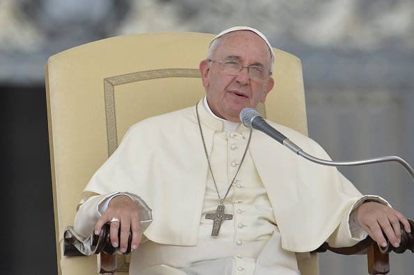Pope Francis addresses the crowd during his weekly general audience at St Peter's square on May 6, 2015 at the Vatican.  AFP PHOTO / ANDREAS SOLARO        (Photo credit should read ANDREAS SOLARO/AFP/Getty Images)