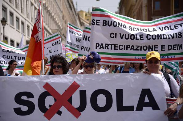 Thousands of Italian teachers and administrators take part in a demonstration organized by the unions of USB, UNICOBAS, and ANIEF to protest against Italian governments Good School reform bill on May 5, 2015 at Piazza de Poppolo in Rome.  AFP PHOTO / FILIPPO MONTEFORTE        (Photo credit should read FILIPPO MONTEFORTE/AFP/Getty Images)