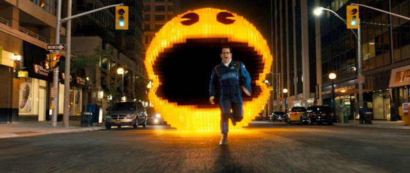 Pac-Man chases Ludlow (Josh Gad) in Columbia Pictures' PIXELS.