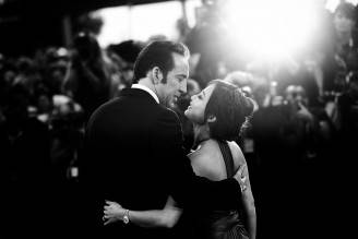 VENICE, ITALY - AUGUST 30:  (EDITORS NOTE: This image was processed using digital filters)  An alternative view of actor Nicolas Cage who kisses his wife Alice Kim Cage at the 'Joe' Premiere during the 70th Venice International Film Festival on August 30, 2013 in Venice, Italy.  (Photo by Vittorio Zunino Celotto/Getty Images)