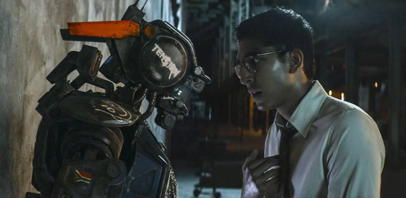 Chappie and his maker (Dev Patel) in Columbia Pictures' action-adventure CHAPPIE.