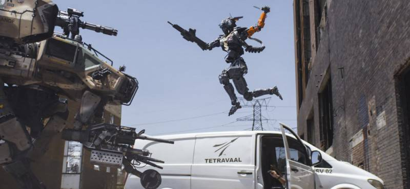 The Moose and Chappie (Sharlto Copley) battle it out in Columbia Pictures' action-adventure CHAPPIE.