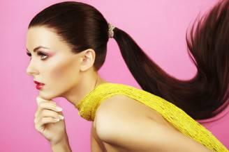 Fashion photo of beautiful woman with ponytail - Photo by Tinkstock