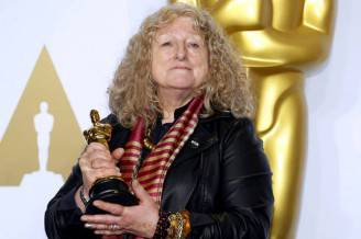 """Jenny Beavan, winner for Best Costume Design for """"Mad Max: Fury Road"""", poses during the 88th Academy Awards in Hollywood, California"""