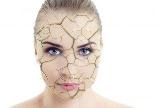 Close-up of woman cracked and damaged face as cosmetic and dehydration effect concept isolated on white background