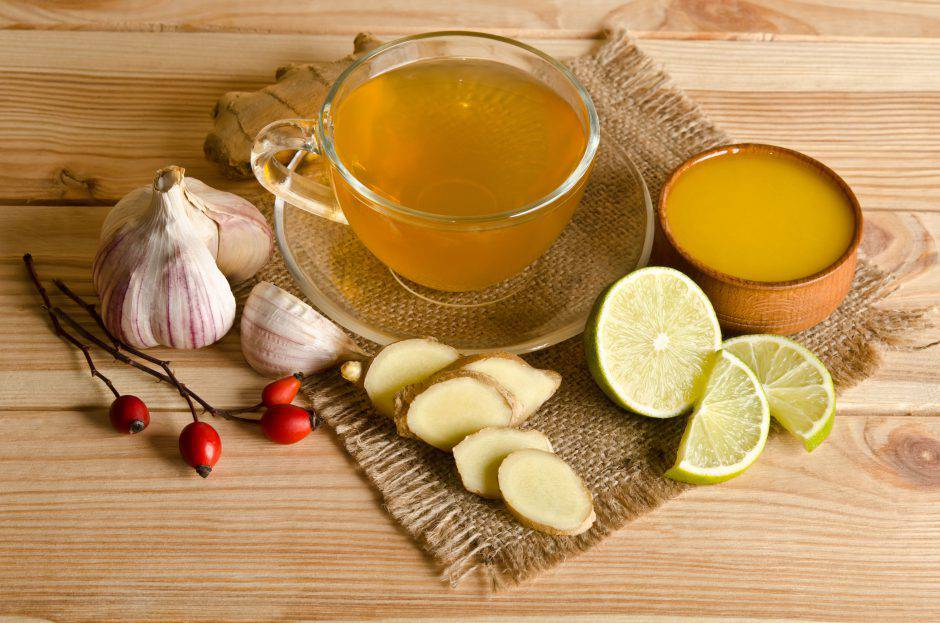 Cup of tea with lemon slices and ginger. Home antimicrobial therapy