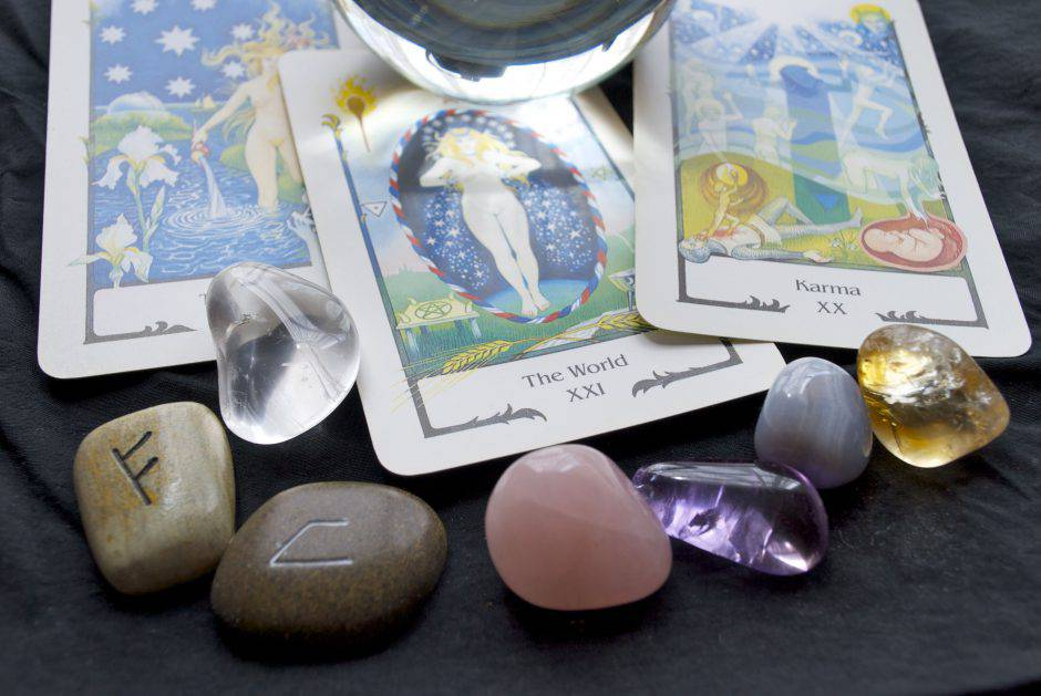 Nelson, NZ - November 4, 2008: Tarot Cards from the Tarot of the Old Path Deck published in 1990 by Swiss AG M?ller. The Cards areshown with other Fortune Telling paraphernalia such as a Crystal Ball, Runes and Gemstone Crystals.