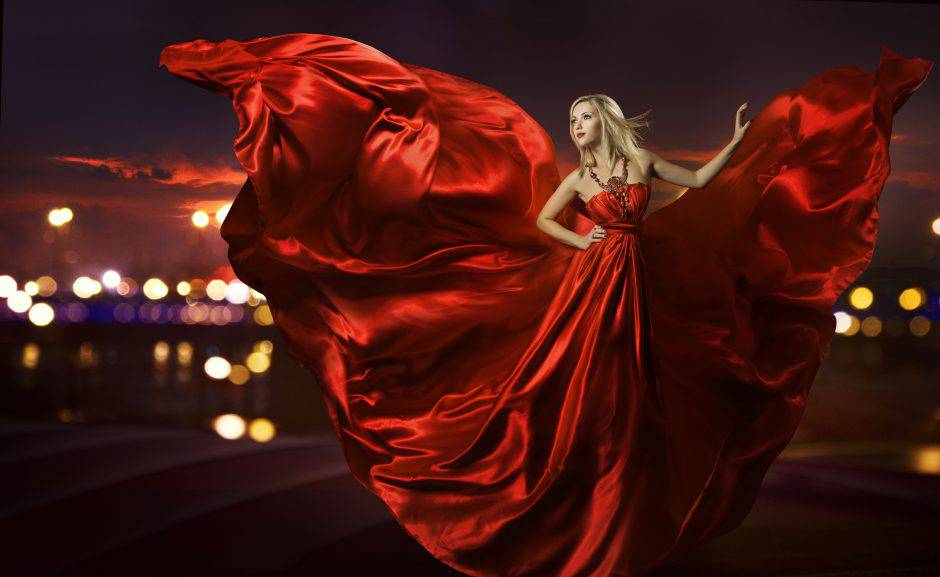 woman dancing in silk dress, artistic red blowing gown fabric