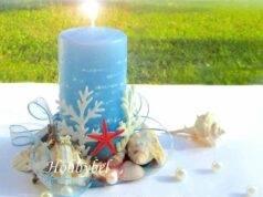 decorazione estiva con candela e conchiglie