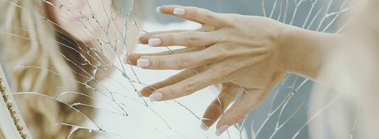 rompere specchio