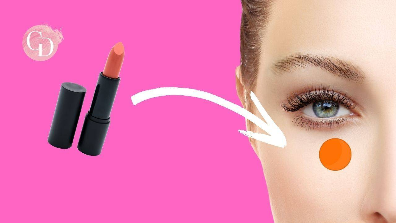occhiaie rossetto aranciato donna con occhiaie