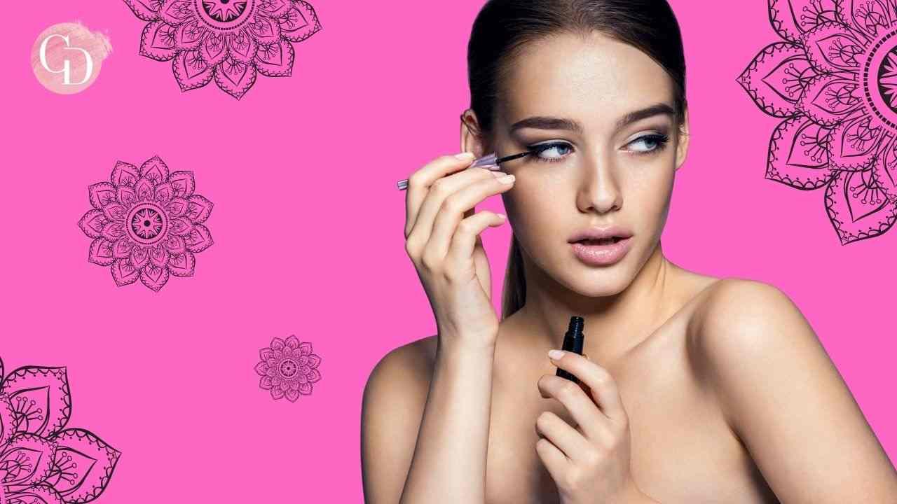Reverse Eye Makeup ragazza su fondo rosa