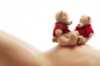 Pregnant woman and teddy bears